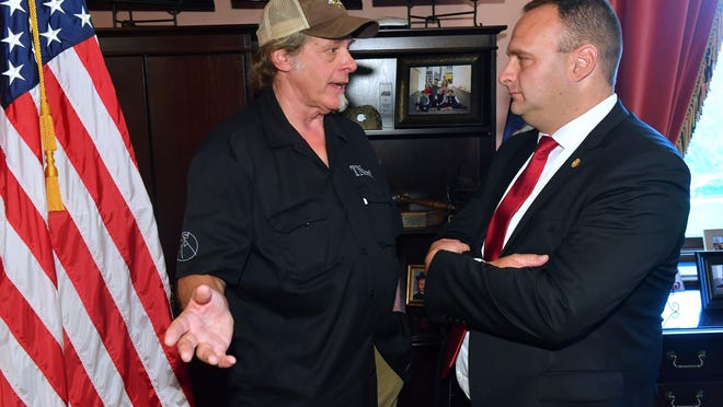 Rock 'n' roll legend Ted Nugent (left) discusses the deer bait band with state Rep. Jason Sheppard, R-Temperance, in Lansing in September of 2019.