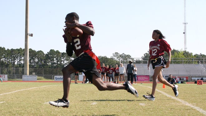 Donte Sims, an ESE student at Chiles, races toward the end zone avoiding defenders during the Timberwolves United's 14-6 win over the JV flag football team.