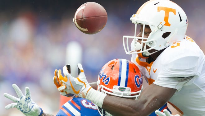 Tennessee wide receiver Brandon Johnson (7) and Florida cornerback Marco Wilson (3) reach for a pass intended for Johnson during the Tennessee Volunteers vs. Florida Gators game at Ben Hill Griffin Stadium in Gainesville, Florida on Saturday, September 16, 2017.