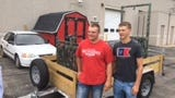 Chasten Fatla, left, and Brock Bogacz with the bear trap they built.