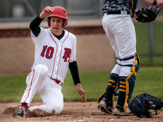 Port Huron sophomore Brett Wagner slides home to score