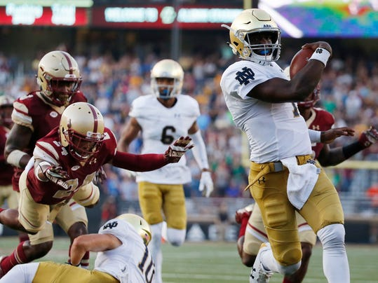 Notre Dame's Brandon Wimbush, right, carries into the end zone ahead of Boston College's Taj-Amir Torres (24) during the second half of an NCAA college football game in Boston, Saturday, Sept. 16, 2017. Notre Dame won 49-20. (AP Photo/Michael Dwyer)