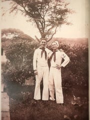 Pearl Harbor survivor John Gideon, right, with one of his fellow sailors in Honolulu in November 1942.