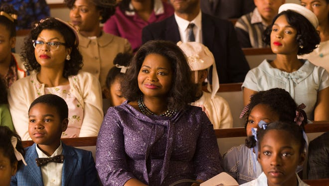 Taraji P. Henson, background left, Octavia Spencer, center, and Janelle Monae, background right, in 'Hidden Figures.' Spencer was nominated for an Oscar for best  supporting actress and the film was nominated for best picture.
