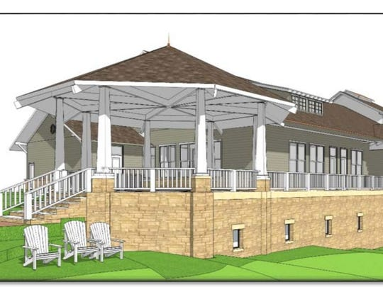 This illustration shows the design for a new clubhouse and support facility at the University of Iowa's Finkbine Golf Course. The Iowa Board of Regents is scheduled to discuss the design and $10 million budget for the project during next week's meeting. UI officials say gifts to the UI Department of Athletics will cover the total cost of the project.