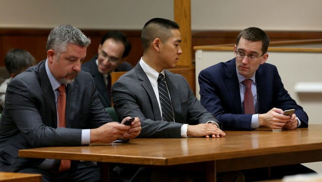 Charles Tan, center, and his lawyers James Nobles, left, and Brian DeCarolis.