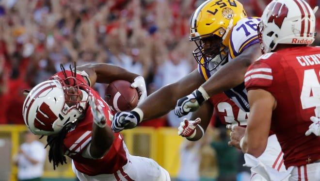 LSU's Josh Boutte hits Wisconsin's D'Cota Dixon after Dixon intercepted a pass Saturday in Green Bay, Wis. Boutte was ejected from the game on the play and has been suspended for one game, LSU announced Monday.