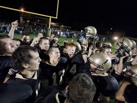 Delone Catholic's players celebrate last Friday's win over Biglerville.