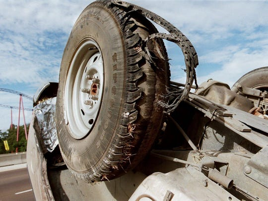 A Ford Explorer sits upside down, with the tread pulled away from the casing of a Firestone FR680 tire, Wednesday, Aug. 9, 2000, in Arlington, Texas.