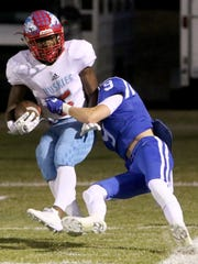 Hirschi's Daimarqua Foster if tackled into the endzone for a touchdown by a  Decatur defender Friday, Oct. 20, 2017, in Decatur at Eagles Stadium.