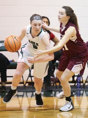 Archmere's Madison Stewart (left) was named to the All-Diamond State Conference girls basketball first team.