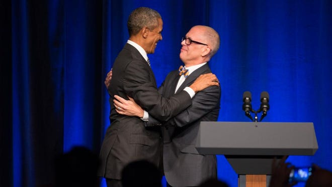 President Barack Obama greets Jim Obergefell, the named plaintiff in the same-sex marriage case decided by the U.S. Supreme Court, as he is welcomed to the stage to speak at a Democratic National Committee LGBT fundraising gala, Sunday, Sept. 27, 2015, held at Gotham Hall in New York.