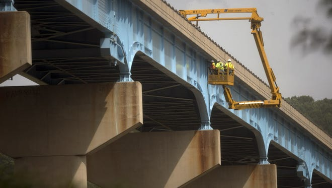 PennDOT and consultants inspect the Norman Wood Bridge in September after a crack was found. The bridge had to be closed for repairs.
