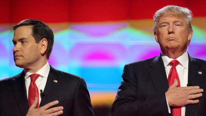 Marco Rubio and Donald Trump attend the Republican National Committee Presidential Primary Debate at the University of Miami's Bank United Center, in Miami, Florida March 10, 2016.
