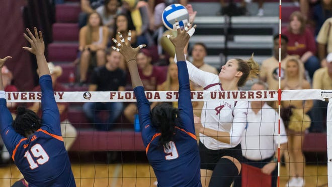 Katie Horton delivers a kill for FSU vs. Syracuse.