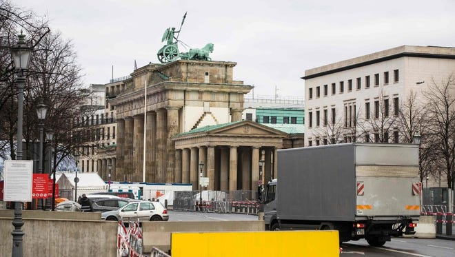 A truck is let through a concrete barrier in front of the Brandenburg Gate, a Berlin landmark, on Dec. 29.