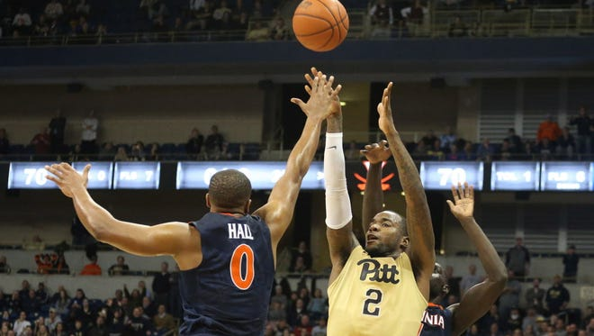 Pittsburgh forward Michael Young (2) shoots against Virginia.