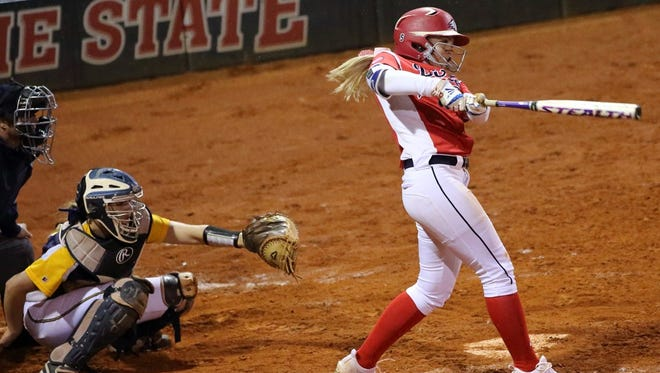Dixie State's Bailey Gaffin hits a grand slam to give DSU a 13-5 win over Montana State Billings last week. It was the second grand slam on the day for DSU.