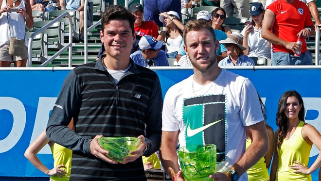 Milos Raonic and Jack Sock pose with their trophies after the 2017 Delray Beach Open.