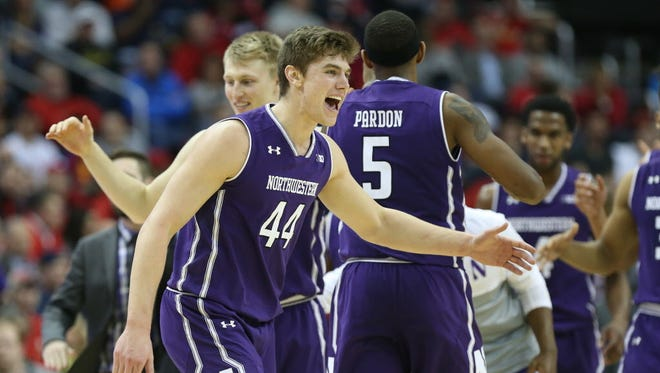 Northwestern forward Gavin Skelly (44) celebrates with teammates after defeating Maryland in the Big Ten tournament.