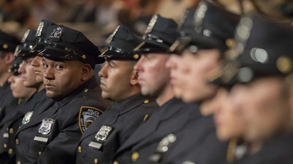 The newest members of the New York City police listen