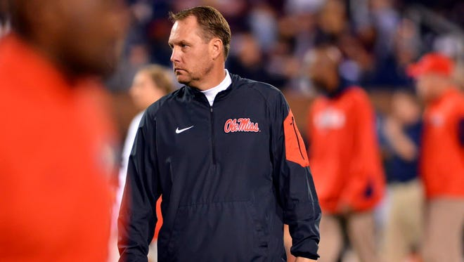 Mississippi Rebels head coach Hugh Freeze walks through warm ups before the game against the Mississippi State Bulldogs at Davis Wade Stadium.
