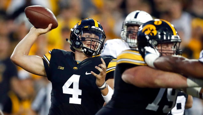 Iowa quarterback Nate Stanley (4) throws during the first half of an NCAA college football game against Penn State, Saturday, Sept. 23, 2017, in Iowa City, Iowa. (AP Photo/Jeff Roberson)