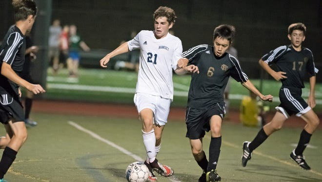 Brian Miller (21) is one of the leaders on the front line for Paramus.