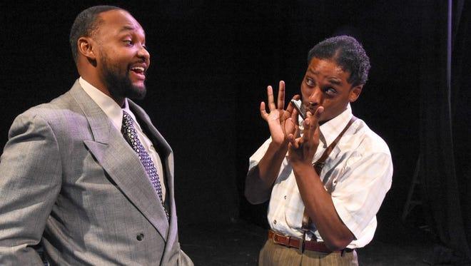"Rapheal Hamilton (left) and Calvin J. Worthen in Black Theatre Troupe's production of ""Seven Guitars."""