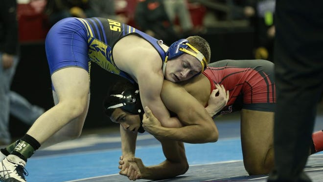 Campbellsport's Matt Koelbl, top, wrestles Neillsville/Greenwood/Loyal's Stephen Buchanan during a 182-pound Division 2 consolation match Friday at the WIAA state wrestling tournament in Madison.