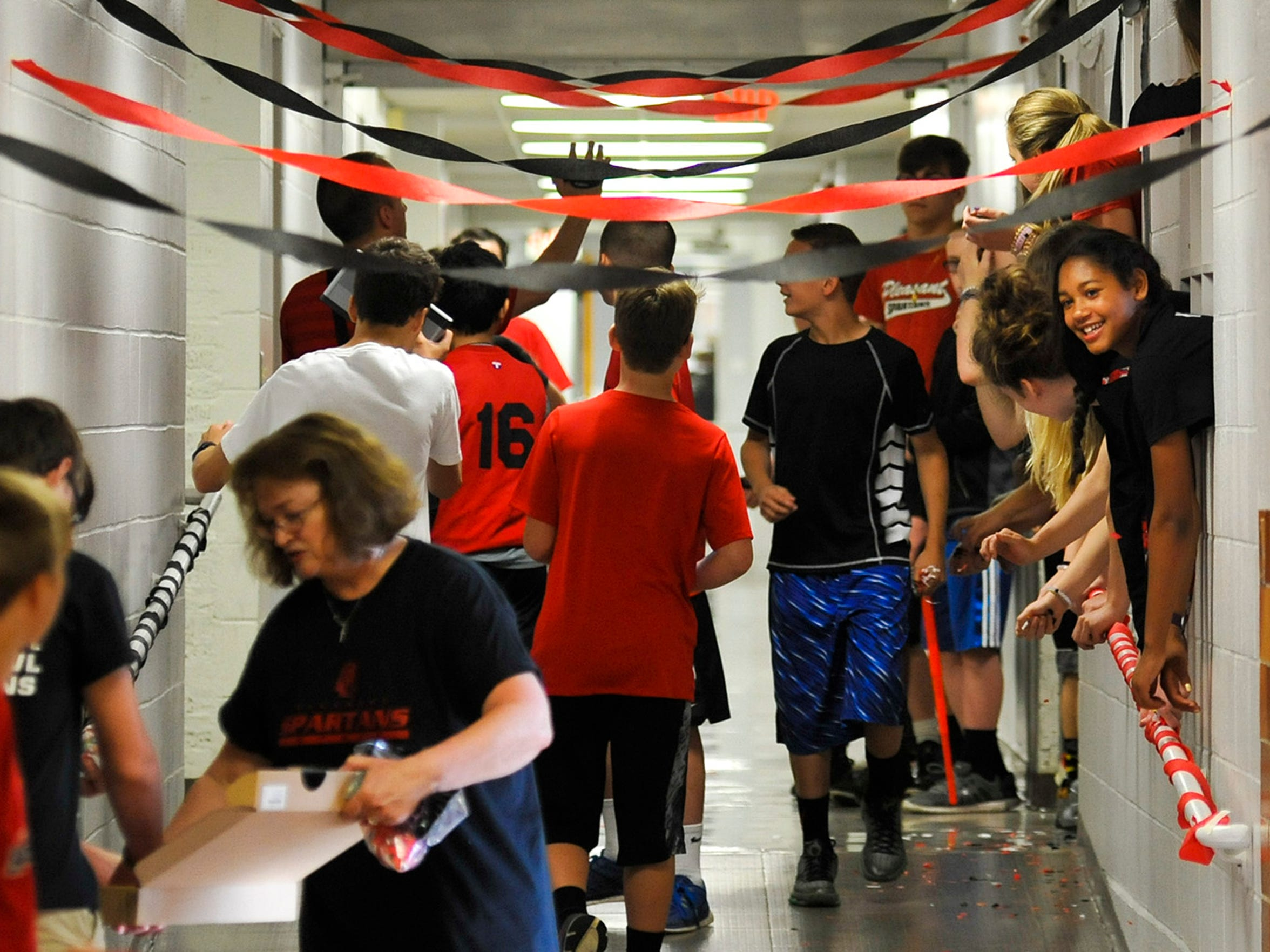 Pleasant students prepare in one of the hallways of the school for their part in a video celebrating the 100th birthday of Pleasant Middle School.