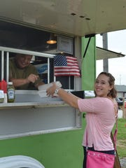 Amanda Forand of Millville purchases lunch from George