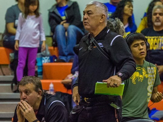 At right, Herb Stinson, assistant coach for the Aztec wrestling team, and head wrestling coach Monte Maxwell watch a match during the Aztec Tiger Duals on Jan. 23 at Lillywhite Gym in Aztec.