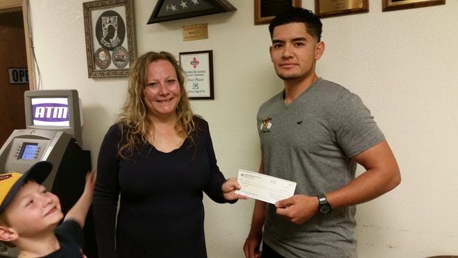 Deming Elks 2750 Treasurer Tammy Zumwalt presented a check to Luis Carreon for $2,000 to help with medical expenses.