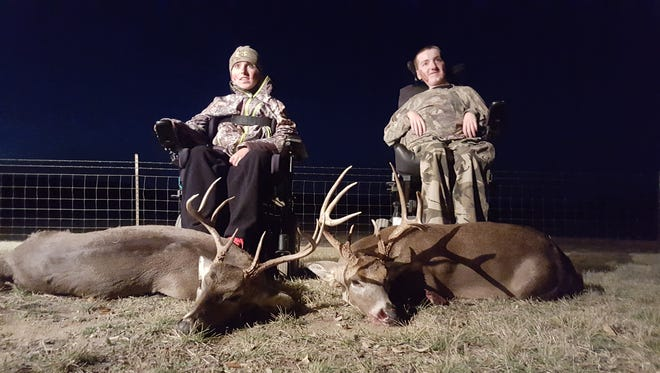 Zach Donahue (left) and Cole Desselle pose with the bucks they killed last month with the help of Dream Hunt Foundation.