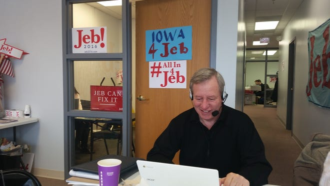 Indiana Republican Mike Murphy, former Marion County GOP chairman, works as a campaign volunteer and is seen encouraging a voter to attend a Jeb Bush event in Okoboji, Iowa.