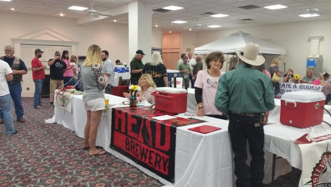 Pourers and tasters of Northern Nevada craft beers interact July 9 at the Copper Hills Brewfest in Yerington, presented by Soroptimists International.