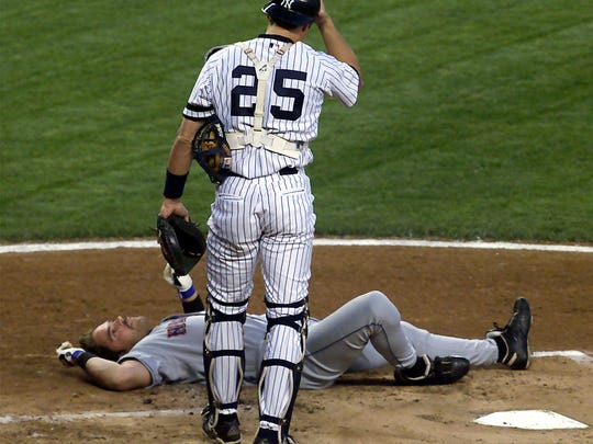 Mets' Mike Piazza lies in the dirt after being hit