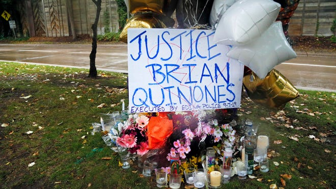 A memorial stands in Richfield, Minn., on Sept. 9, near where police shot and killed Brian J. Quinones-Rosario, who had streamed himself live on Facebook during a police chase after he apparently emerged from his car holding a knife and refused their commands to drop it.