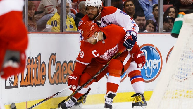 Detroit Red Wings left wing Henrik Zetterberg (40) skates with the puck as Washington Capitals left wing Alex Ovechkin (8) defends in the first period at Joe Louis Arena.