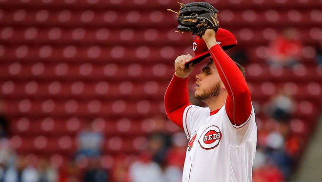 Cincinnati Reds starting pitcher Rookie Davis (54) composes himself on the mound in the first inning during the interleague baseball game between the New York Yankees and the Cincinnati Reds, Monday, May 8, 2017, at Great American Ball Park in Cincinnati.
