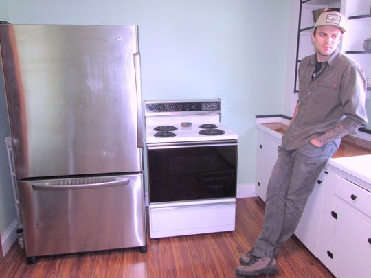 Co-owner Ian Montgomery shows off the kitchen at The Local, a new hostel in downtown Watkins Glen.