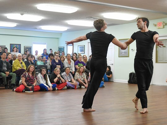 Cody Miley (left) and Marie Madera with the Indianapolis dance company Dance Kaleidoscope interpret one of the Women's Addiction Recovery Manor resident's stories Thursday.