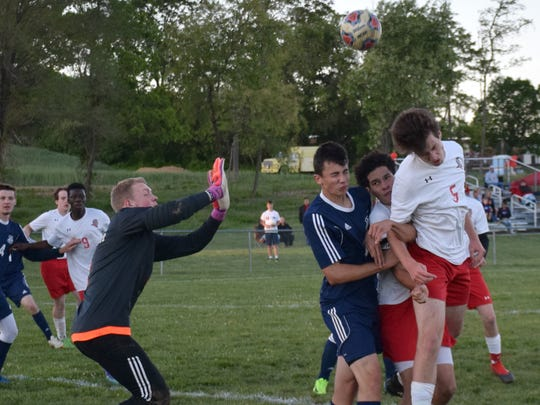 Riverheads' Evan Wood, right, tries to head the ball past Page County keeper Bobby Pendleton, left, off a corner kick as teammate DeyShon Hartley and Page County's Ryan Taylor battle for position during the first half of their Shenandoah District boys soccer game on Monday, May 8, 2017, at Riverheads High School. The Gladiators won 2-0.