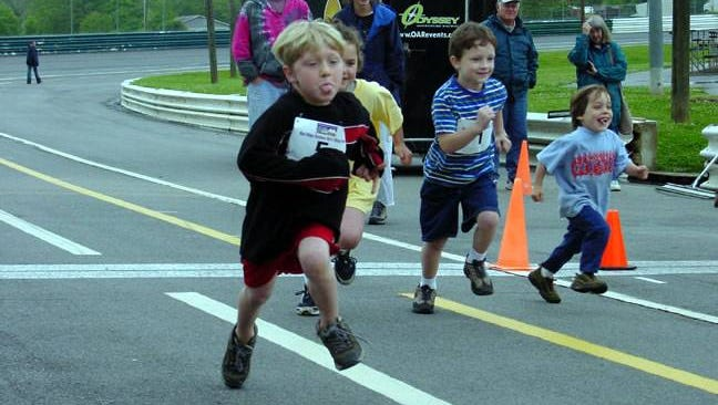 Kids take part in a past race at the Carrier Park track. The EarthFare 5K will be May 9 at the track off Amboy Road in Asheville.