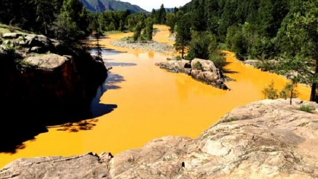 The Animas River turned yellow as a spill from the Gold King Mine poured into the water.