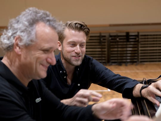 """Cincinnati Symphony Orchestra music director Louis Langrée, left, and stage director James Darrah during a piano rehearsal for their upcoming production of Claude Debussy's """"Pelléas et Mélisande."""" The production, a collaboration between the CSO and the Cincinnati Opera, takes place Oct. 20-21 in Music Hall."""