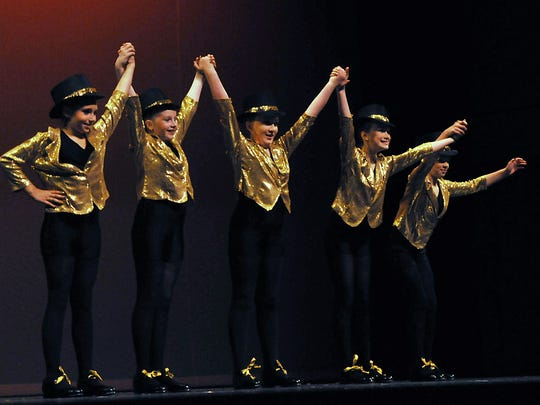 Taking a bow are, from left, Caitlin Gieseler, Makenzie