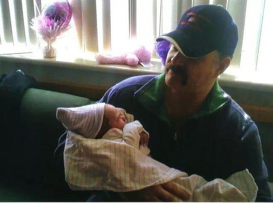 Hackett and grandbaby
