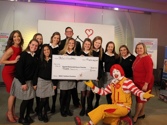 Padua's service group, Ronald's Rescue, participatee in the Ronald McDonald House Charities Telethon, presenting a donation of $3,000 to the Delaware house.